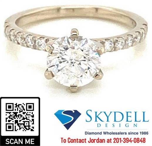 2.47 ctw. Round Brilliant Cut Diamond in a French Pave Setting!